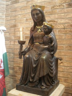 Our Lady of the Taper, holding the child Jesus and a lit candle