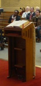 The pulpit at St Philip Evans Church, bearing an open Lectionary