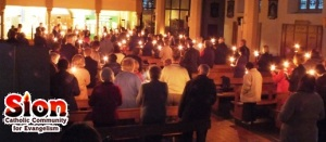 People in a church holding candles, and the Sion Community logo
