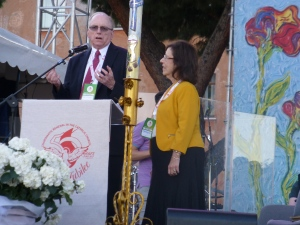 David Mangan and Patti Gallagher Mansfield stand at a pulpit